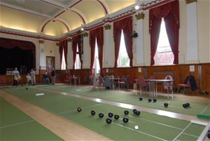Mat bowls being played in the Assembly Room at Victoria Hall